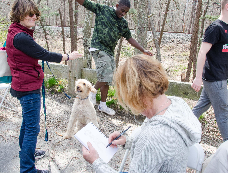 Carol Saxe busy sketching pets