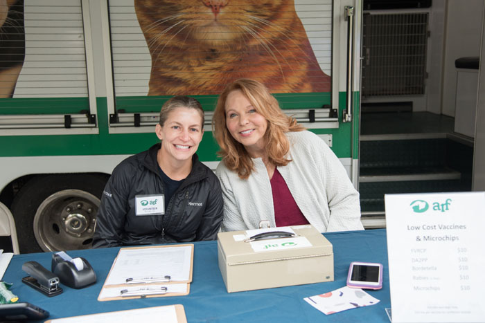 Volunteers Michele Backman and Pat Franzino help out with our low cost vaccine clinic.