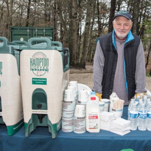 Volunteer Paul Hecht helps out with hot coffee from Hampton Coffee Company