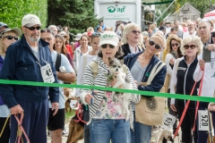 ARF supporter, adopter, volunteer and the 2017 top fundraiser Susan Macy and Fred cut the ribbon to start the walk.