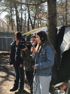 Students film in the dog training pen
