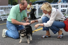 Volunteer Bill Sullivan with Noodle and a potential adopter.