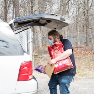 ARF's Jake Kommer helps unload donations.